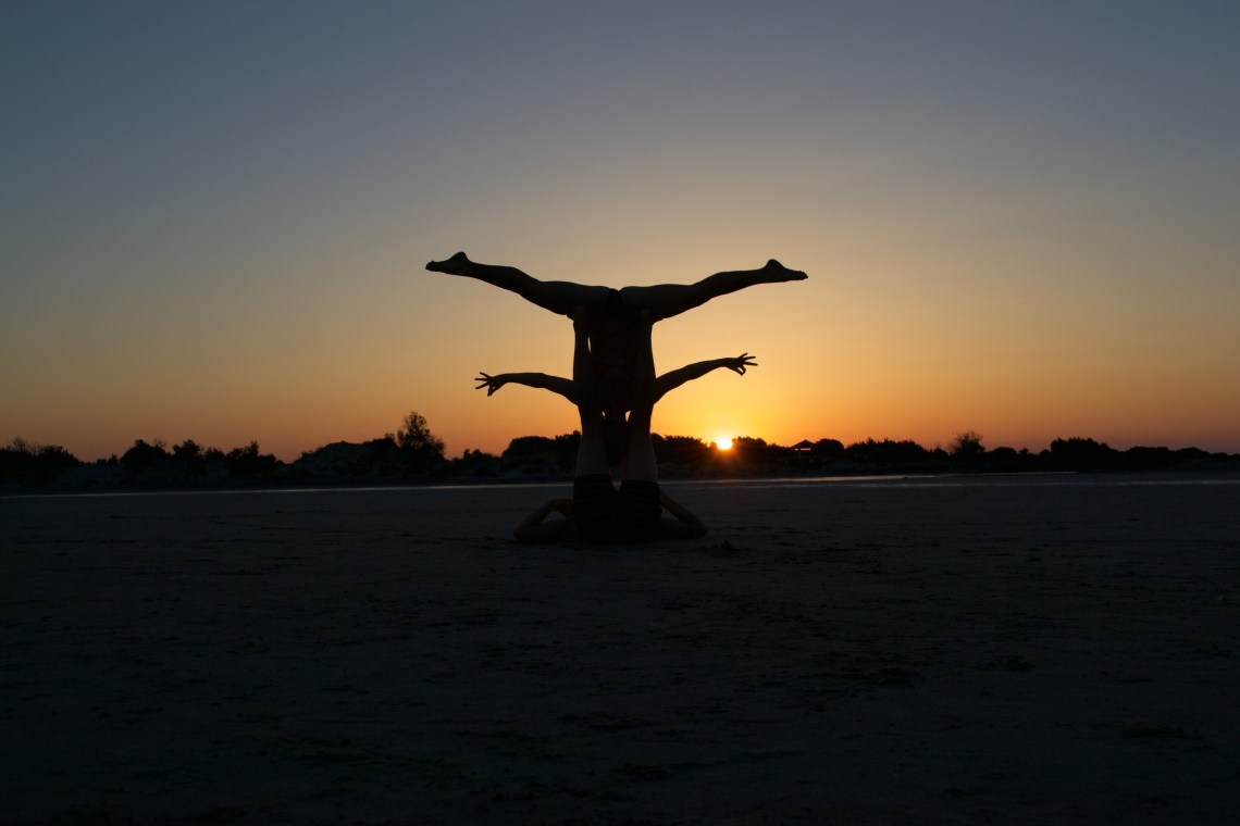 Acroyoga Silhouette Sunset at Elafonisi Beach, Crete, Greece