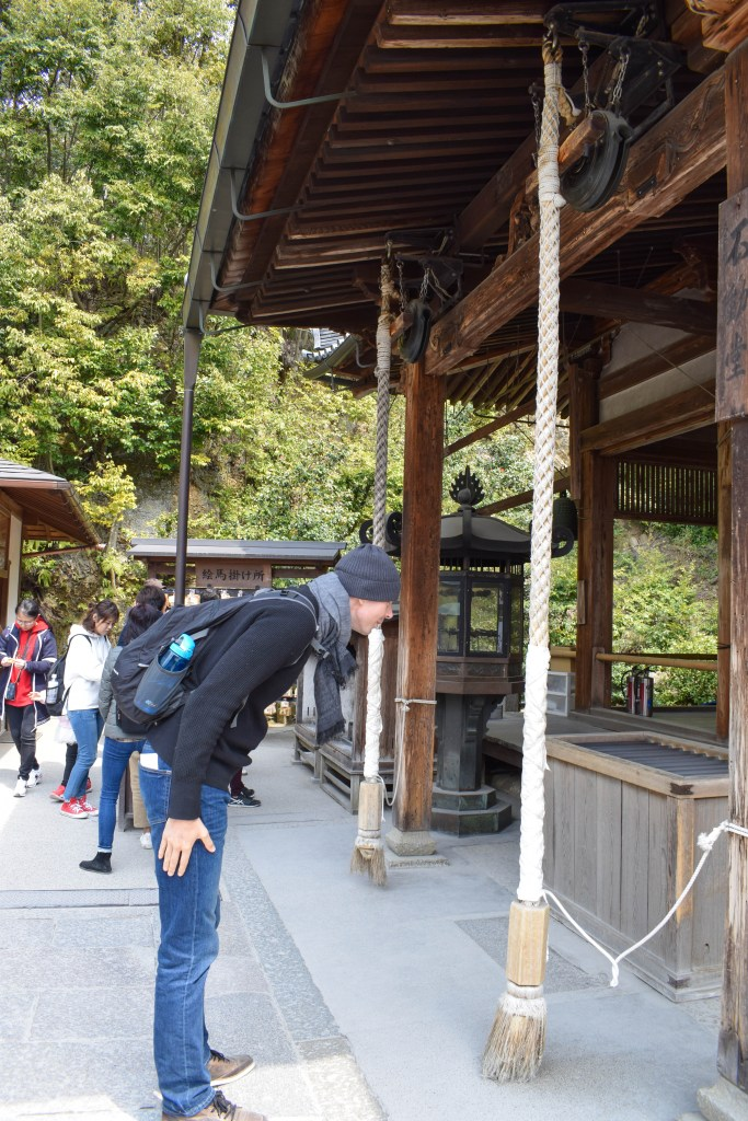 Bowing at a Japanese Temple in Japan
