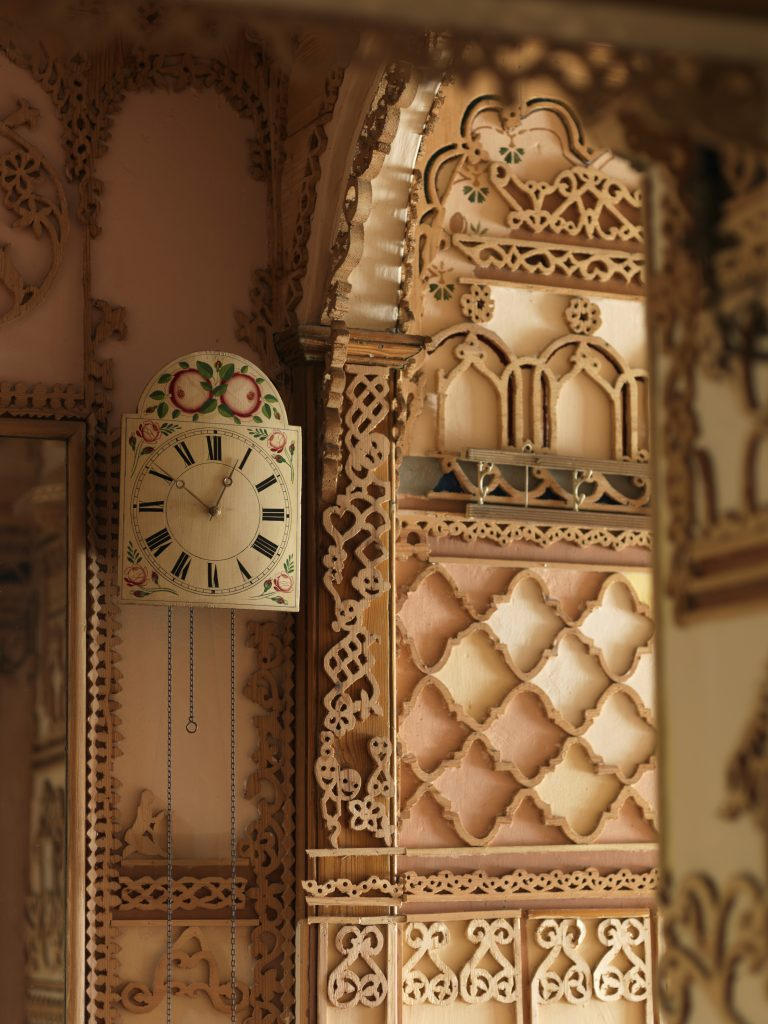 fretwork festooned hallway with clock