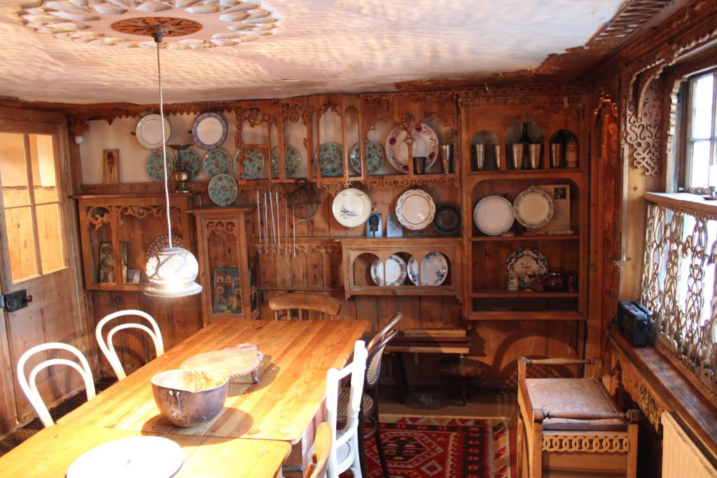 Basement room covered with fine fretwork with large pine table