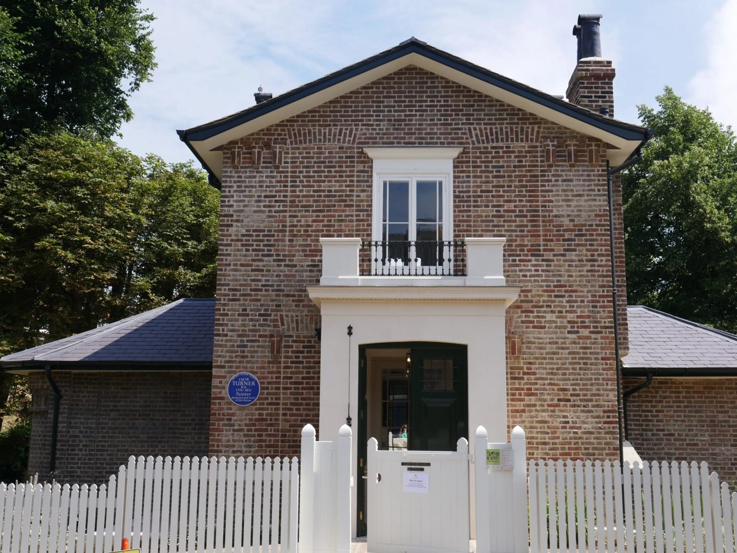 Simple brick built Georgian house, front door and one window Turners House