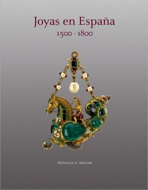 Portada del libro con pendiente en forma de criatura fantástica hecho con esmeraldas, perlas y oro