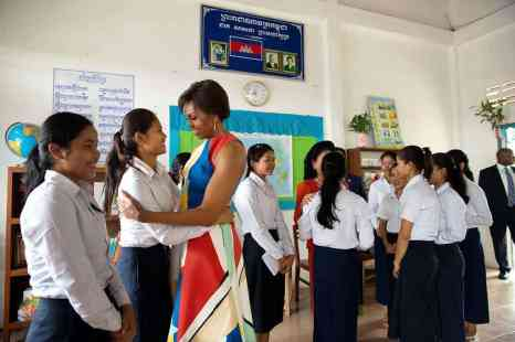 First Lady Michelle Obama and First Lady Bun Rany of Cambodia greet students during a Room to Read event in support of the Let Girls Learn initiative, at Hun Sen Prasat Bakong High School in Siem Reap, Cambodia, March 21, 2015. (Official White House Photo by Amanda Lucidon) This official White House photograph is being made available only for publication by news organizations and/or for personal use printing by the subject(s) of the photograph. The photograph may not be manipulated in any way and may not be used in commercial or political materials, advertisements, emails, products, promotions that in any way suggests approval or endorsement of the President, the First Family, or the White House.