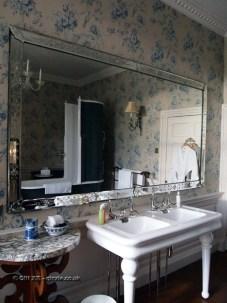 Bathroom reflection at Balfour Castle