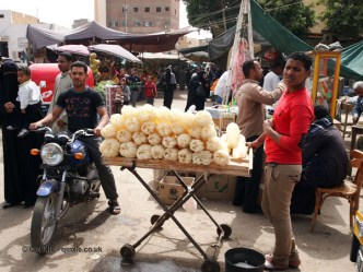 Man selling loofah, Edfu, Egypt