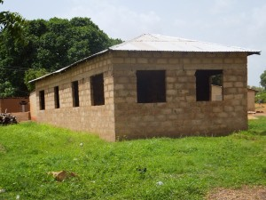 Example of the concrete block structures that residents at my field site are striving to build