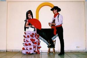 Bergeon and Alvarez wearing traditional Spanish flamenco attire