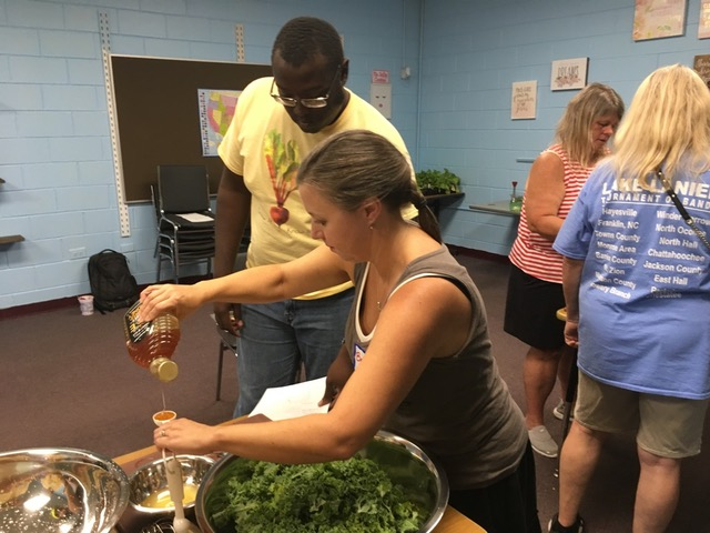 Grow It Know It VISTA and Barrow County, GA, teachers practicing a culinary nutrition lesson using kale harvest from Wimberly's Roots Farm