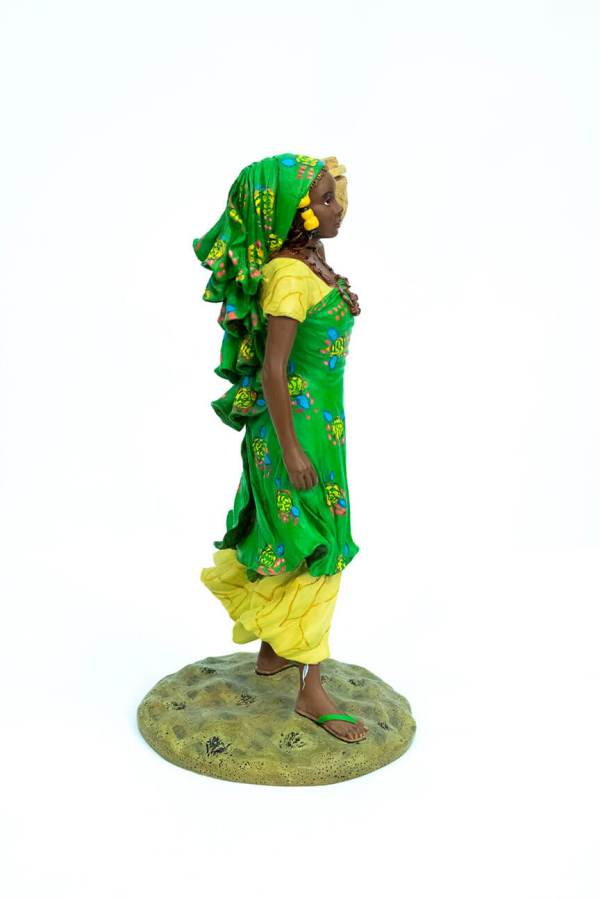 African figurine, Peul woman in green dress holding basket, right