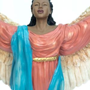 Angel figurine, arms open, wings spread open, closeup