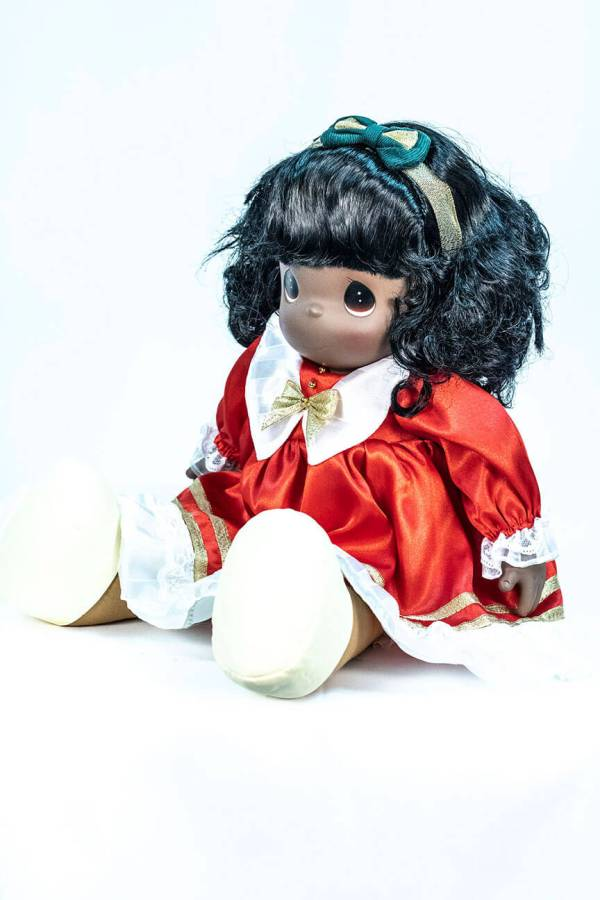 doll, baby doll sitting in red dress, left