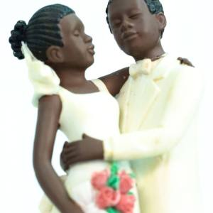 wedding couple figurine, dancing bride and groom in white, closeup