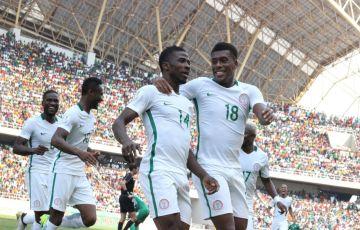 Super Eagles players, Kelechi Ihenacho of Man City and Alex Iwobi celebrate a goal