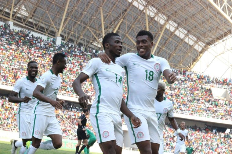 Super Eagles players, Kelechi Ihenacho of Man City and Alex Iwobi celebrate a goal