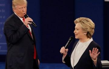 Republican presidential nominee Donald Trump and Democratic presidential nominee Hillary Clinton speak during the second presidential debate at Washington University in St. Louis, Sunday, Oct. 9, 2016. (AP Photo/Patrick Semansky)