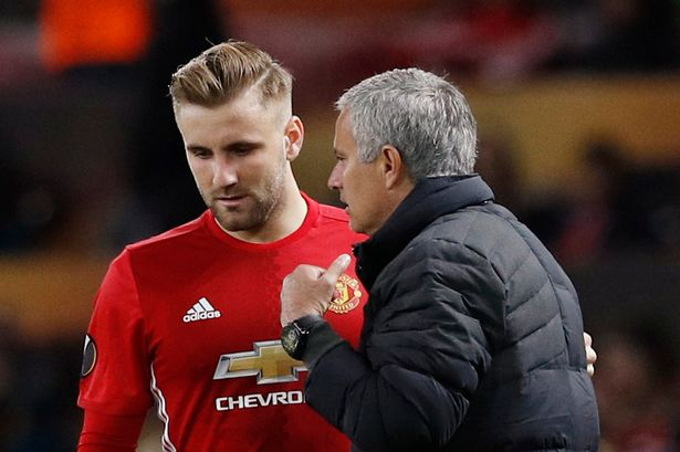 Jose Mourinho giving Luke Shaw instructions