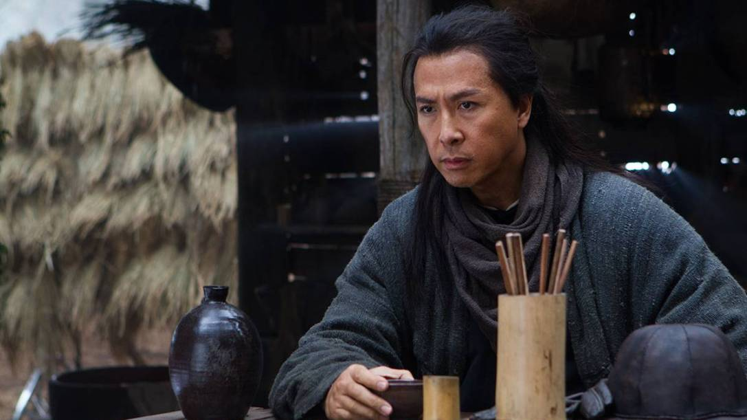 "A screenshot from Netflix's ""Sword of Destiny"", showing Donnie Yen in a long dark wig and traditional Chinese robes."