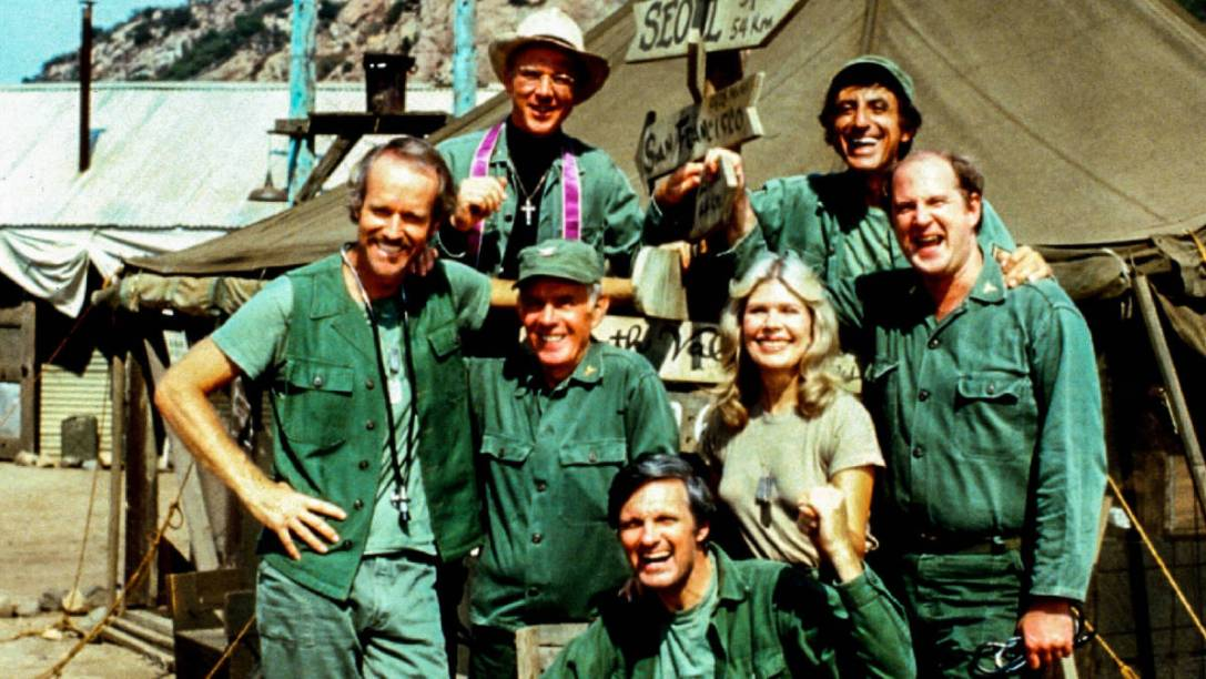 """M*A*S*H (CBS) 1977-1983 Shown: clockwise from bottom, Alan Alda (as Capt. Benjamin Franklin """"Hawkeye"""" Pierce), Harry Morgan (as Col. Sherman T. Potter), Mike Farrell (as Captain BJ Hunnicut), William Christopher (as Father John Patrick Francis Mulcahy), Jamie Farr (as Corporal/Sergeant Maxwell Q. Klinger), David Ogden Stiers (as Charles Emerson Winchester III), Loretta Swit (as Major Margaret J. """"Hot Lips"""" Houlihan) decades"""