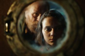 Programme Name: His Dark Materials - TX: n/a - Episode: The Spies (No. 3) - Picture Shows: Farder Coram (JAMES COSMO), Lyra Belacqua (DAFNE KEEN) - (C) Bad Wolf - Photographer: screen grab