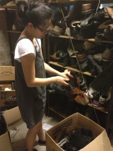 Jammie sorts shoes during a service project in Berlin, Germany. (Photo by Bjorn Karlman)