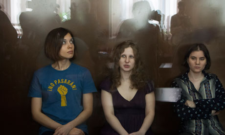 Pussy Riot members, from left, Nadezhda Tolokonnikova, Maria Alyokhina and Yekaterina Samutsevich sit in a glass cage at a court room in Moscow | Photo by Alexander Zemlianichenko
