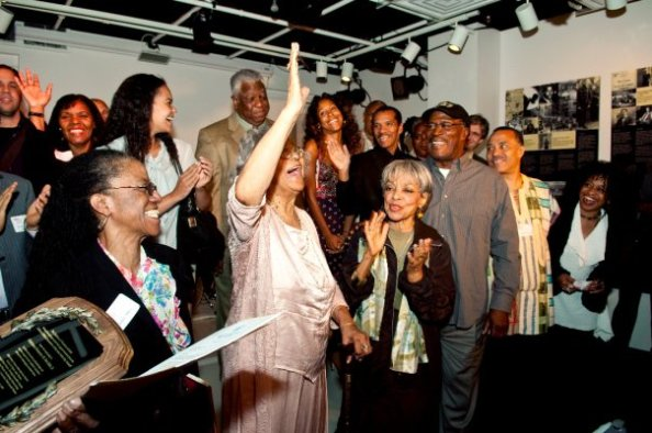 Ms. Gertrude Jeannette makes her presence known. Photo by Michael Palma. — with Janice Jenkins, Pat White, Daniela Sheppard, Woodie King Jr., Ms. Gertrude Jeannette, Miss Ruby Dee, John Amos, Nabii Faison and Jackie Jeffries.| Courtesy of Coalition of Theatres of Color