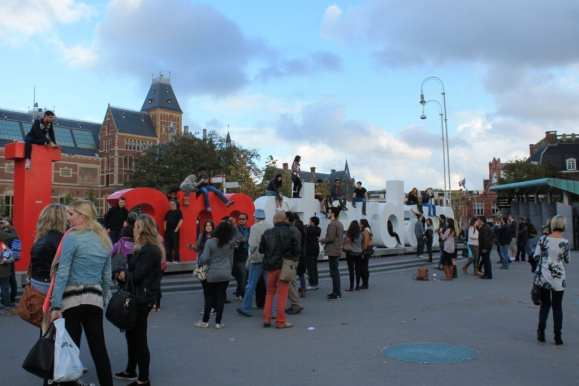 The iAmsterdam sign that tourist climb on top of for a photo opportunity located at Museumplein in Amsterdam, Netherlands.