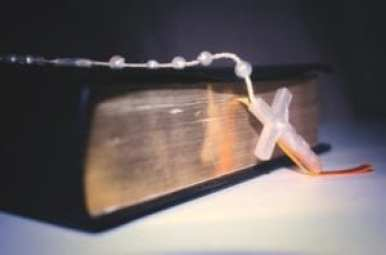 Rosary on a bible - Photo By: Leandro Almeida