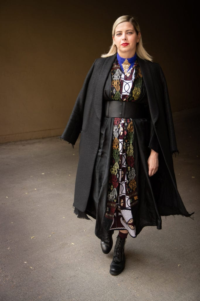 black long coat black wide belt black kimono and black combat boots. does culture affect your style?
