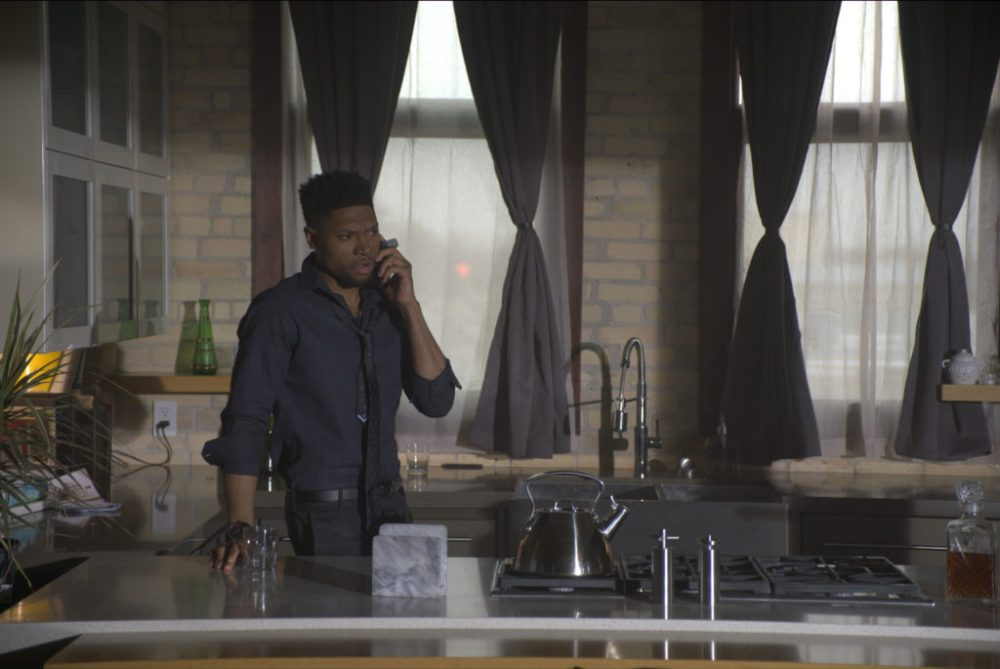 Actor London Brown talking on the telephone as David in the movie Tales From the Hood 3