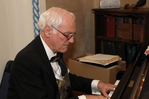 Merrick playing piano