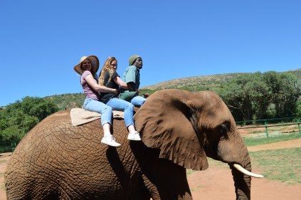Alexia and Cecil riding an elephant