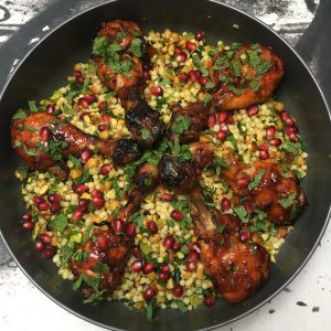 Spicy chicken drumsticks with p'titim salad