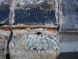 Plancha de plomo destruida