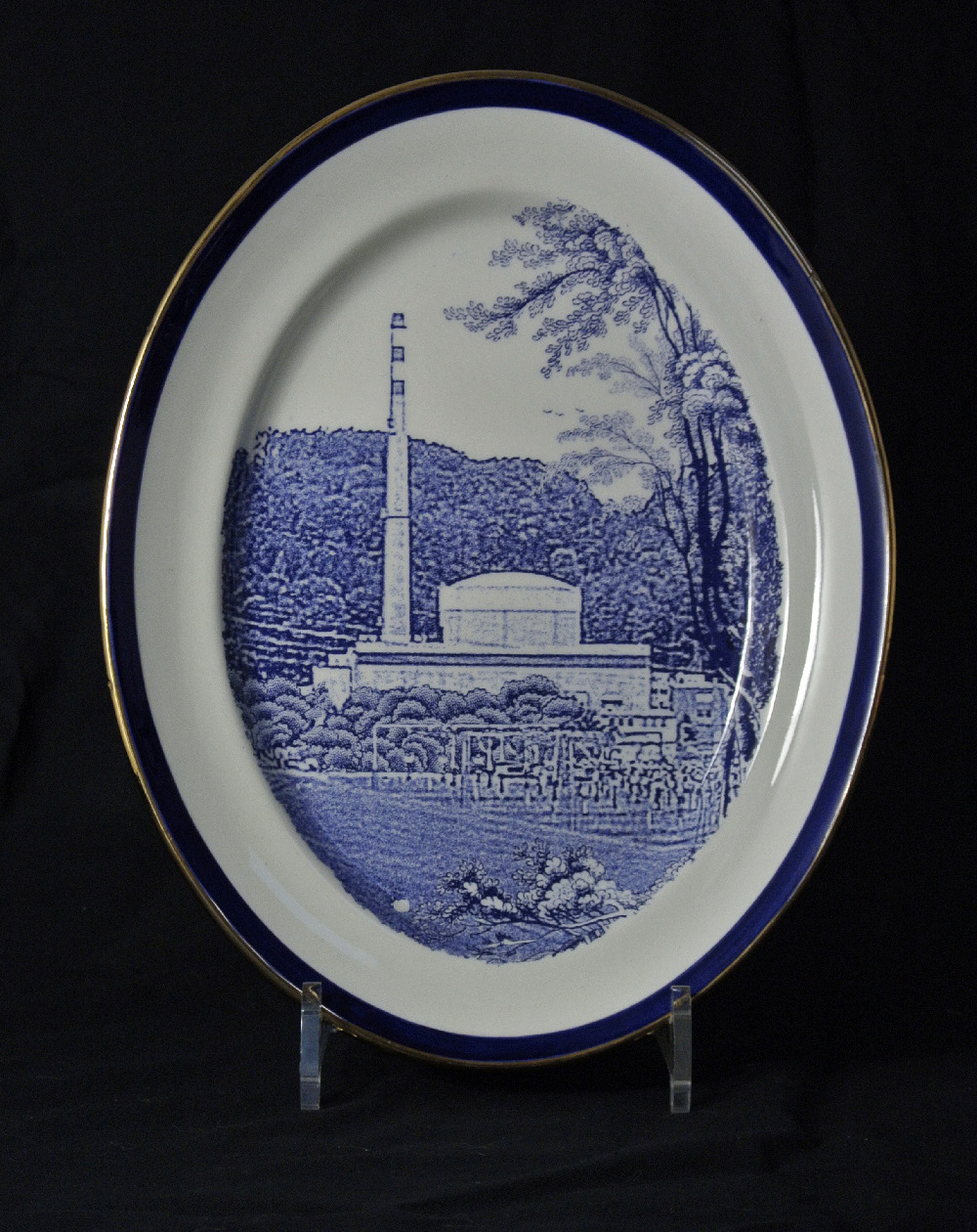 Scott's Cumbrian Blue(s) Müleberg. Inglaze decal collage and gold lustre on old earthenware plate (c.1930) marked (c.1930), marked Bristol Poutney and Co. 22cm x 28cm