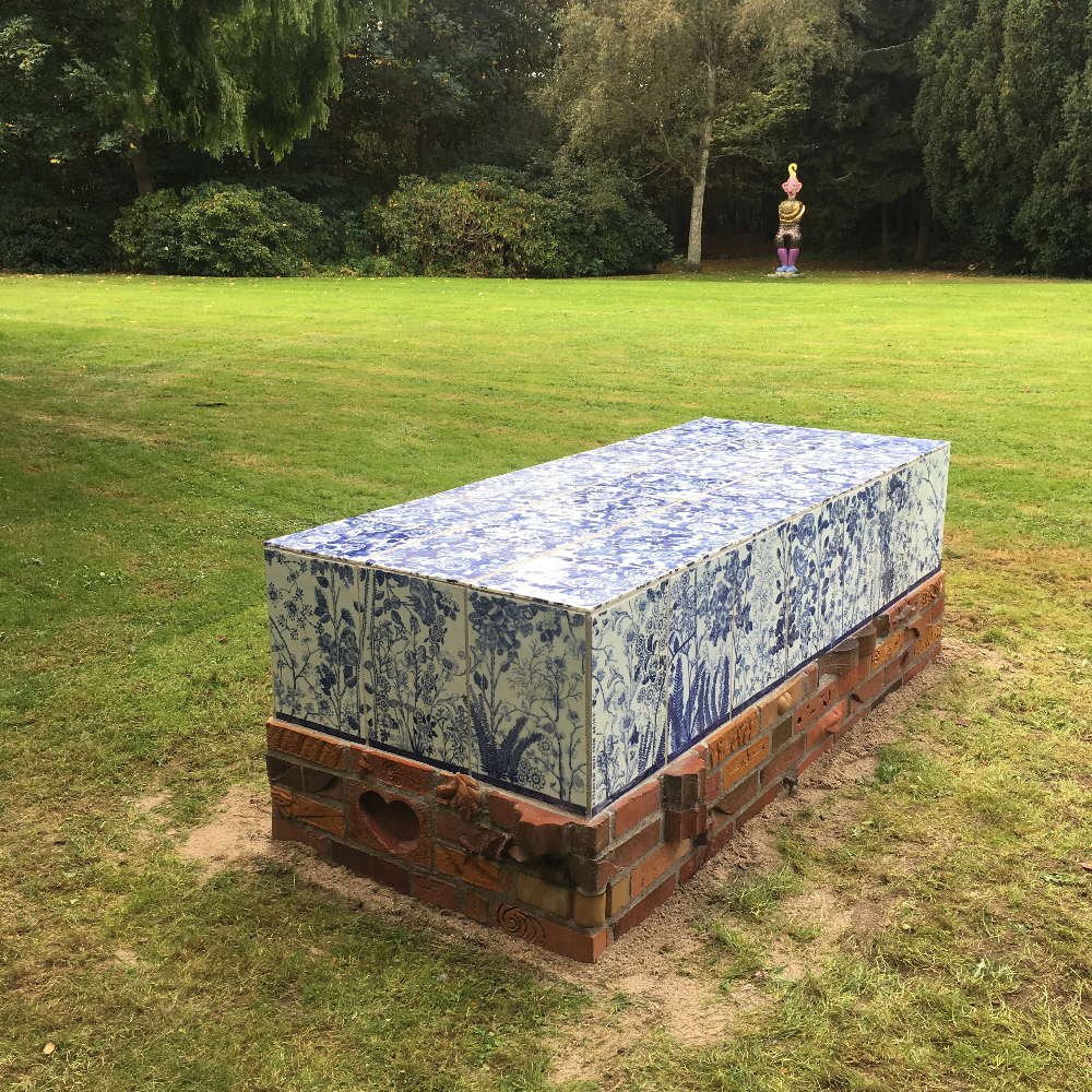 'Scott's Cumbrian Blue(s), A Flowerbed for Alice'. Inglaze decal collage on porcelain tiles on a bed of bricks by Lillemor Petersson. Guldagergård, Skælskør Bygarden, Denmark, 203cm x 90cm x 70cm. Paul Scott and Lillemor Petersson 2016.