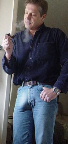 smoking a pipe and showing my big cock bulge