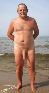mature gentleman showing is beautiful big cock at the beach