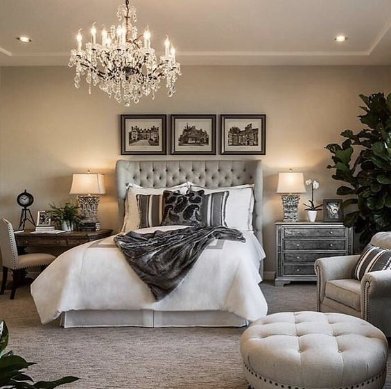 traditional bedroom with chandelier and tufted headboard