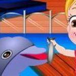 Baby Hazel chơi cùng cá heo