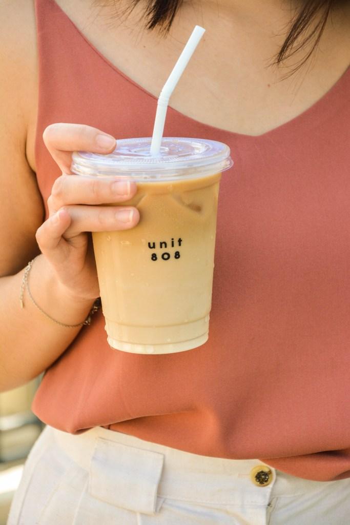 Unit 808 Girl Holding Coffee