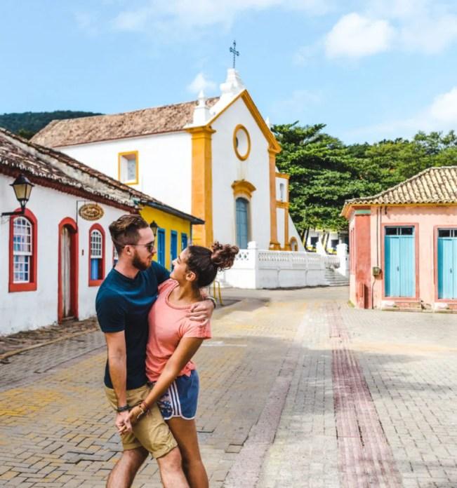 Travel couple at Santo Antonio de Lisboa Floripa church