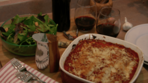 table set with lasagna