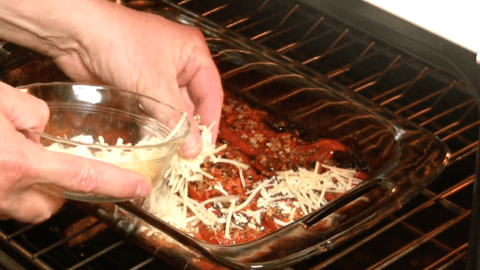 topping tomatoes with cheese