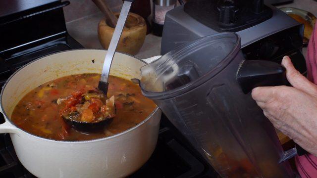 adding soup to blender