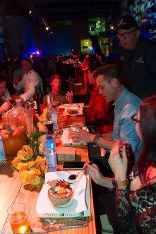 Davin Waitte from Wrench & Rodent describing dish to judges table, Isabel Cruz, Brian Malarkey
