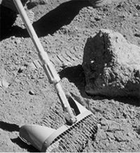 Astronaut collecting soil sample