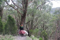 Amy Dale, sitting on a rock in Cleland Conservation Park