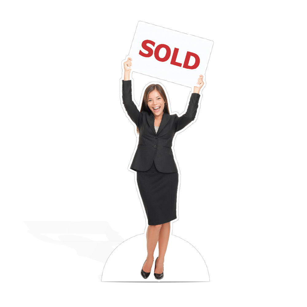 Life Size Cut Out of a woman holding a sold sign