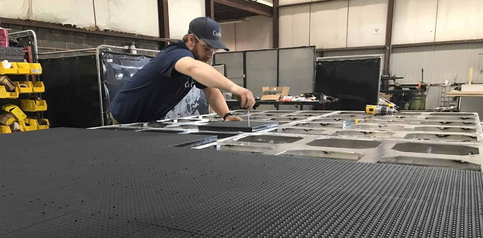 Curbex Employee building a LED display